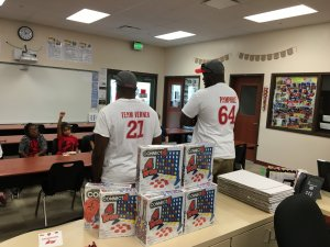 Alterraun Verner and Kevin Pamphile of the Tampa Bay Buccaneers assist in a Tampa, Fla., elementary school.