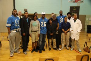 Members of the NFL's Detroit Lions visit Dixon Education Learning Academy in Detroit on May 19, 2015, for a STEM event held by Don Carey