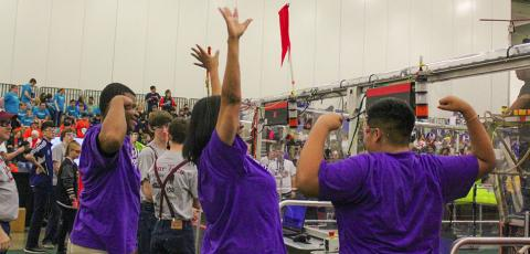 Sunset High School special education teacher Pauline Tatum (middle) cheers along with her students as RoboFlash is announced during the Dallas Regional FIRST Robotics Competition on March 11. Photo: Heather Noel